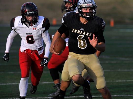 Comanche High School quarterback Trendon Morin scrambles