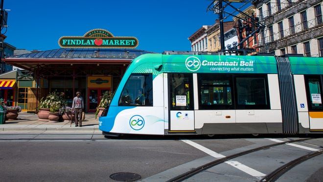 The Cincinnati Bell Connector travels on Race Street after officials revealed its new logo and colors on Aug. 30.