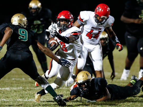 Raleigh-Egypt running back Kayln Grandberry (middle) makes a touchdown run against the MLK Prep defense during first quarter actionThursday evening.