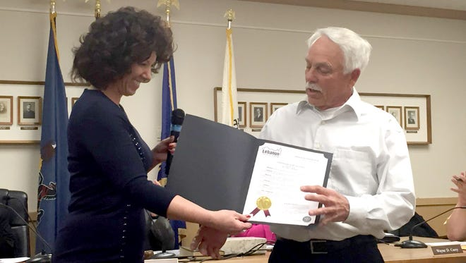 Lebanon Mayor Sherry Capello presents a Certificate of Recognition to Gene Long, a member of the Coleman Memorial Park Board of Trustees, for winning the Keystone Athletic Field Managers Organization's 2015 Field of Distinction Award for the park's baseball field, which he maintains.
