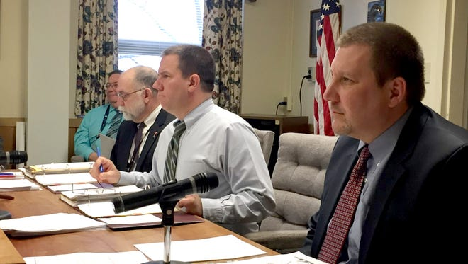 The Lebanon County Board of Elections, from right, Judge Charlie T. Jones, county administrator Jamie Wolgemuth and President Judge John C. Tylwalk discuss the primary election ballot before approving it on Thursday.