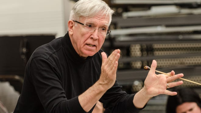 Douglas Bianchi directs the International Symphony Orchestra Tuesday, April 18 during one of their practices at St. Clair County Community College.