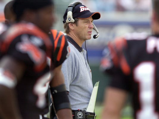 Text: 2000.10.01.08.01 BENGALS SPORTS NIKON DIGITAL IMAGE: The Cincinnati Bengals' Dick LeBeau dawns his headphones for the first time as the new haed coach of the Bengals in Sundays game against the Miami Dolphins at Paul Brown Stadium. Jeff Swinger/Cincinnati Enquirer js