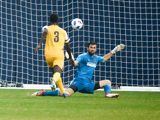 Nashville SC forward Ropapa Mensah (3) kicks a goal