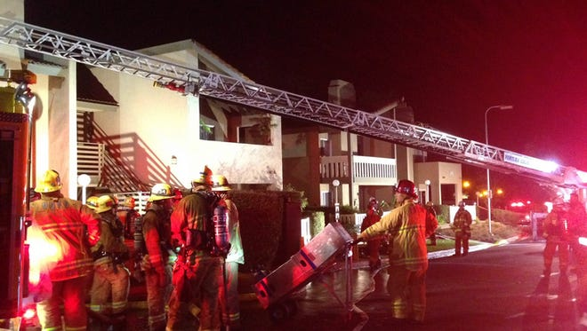 Crews work at the scene of an attic fire that displaced 16 people Thursday in Thousand Oaks.