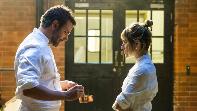 """This photo provided by The Weinstein Company, shows Bradley Cooper, left, as Adam Jones, and Sienna Miller as Helene, in a scene from the film, """"Burnt."""""""
