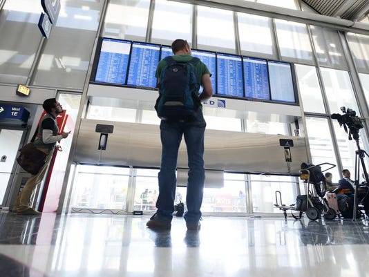 1411751055008-AP-Chicago-Airports-Ground-Stop1.jpg