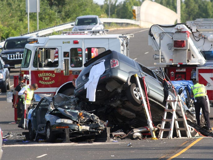 Scene of a fatal accident on Kozloski Road near the entrance ramp to Route 33 West in Freehold Township. Tuesday August 20, 2014, Freehold Township,  NJ.    Photo by Robert Ward