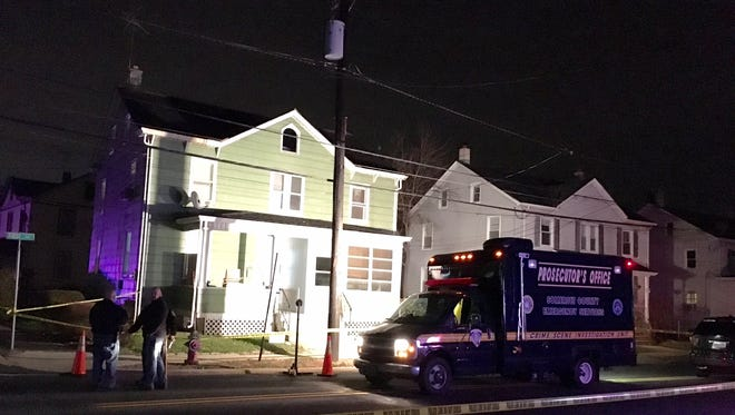 Investigators work Friday night on First Avenue in Raritan Borough at the scene of a homicide.