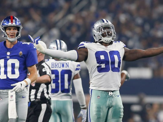 Cowboys defensive end Demarcus Lawrence reacts after sacking Giants quarterback Eli Manning on Sept. 16.