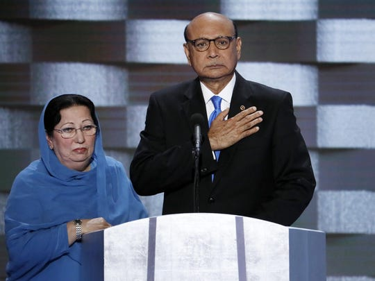 Khizr Khan, father of fallen US Army Capt. Humayun S. M. Khan and his wife Ghazala speak during the final day of the Democratic National Convention in Philadelphia.