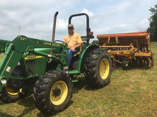 Rep. Jay Reedy planting industrial hemp on his Erin