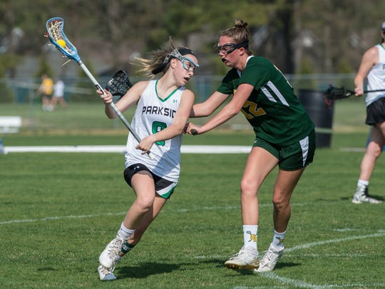 Parkside's Kaitlyn Morris (9) looks for a pass during a game against Queen Anne's on Wednesday, April 25, 2018.