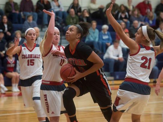 Central York's Teirra Preston drives toward the basket