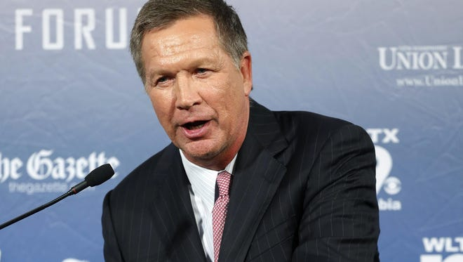 Ohio Gov. John Kasich, a GOP presidential candidate, said a Kentucky clerk's battle over same-sex marriage could turn people off to Christianity. Here, Kasich speaks during a forum last month in Manchester, N.H.