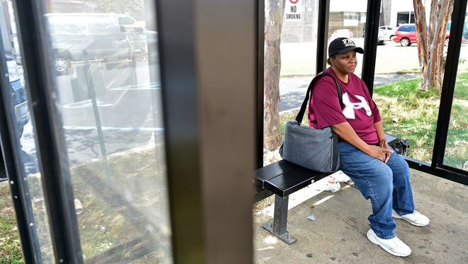Jackson resident Gladys Bunzy sits at a JATRAN bus stop on Robinson Road Monday. Unreliable public transportation in Jackson puts a severe damper on her independence, Bunzy said.