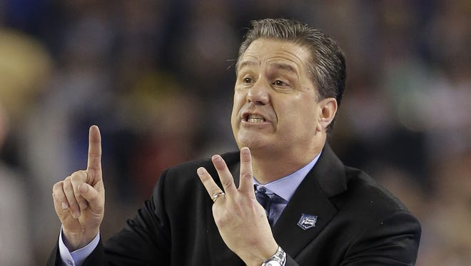 Kentucky head coach John Calipari directs his team during the first half of the NCAA Final Four tournament college basketball championship game against Connecticut, April 7, 2014, in Arlington, Texas.
