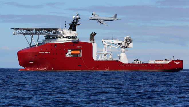 A Royal Australian Air Force AP-3C Orion flies past the Australian Defense vessel Ocean Shield on a mission to drop sonar buoys to assist in the acoustic search for the missing Malaysia Airlines jet in the southern Indian Ocean on April 9.