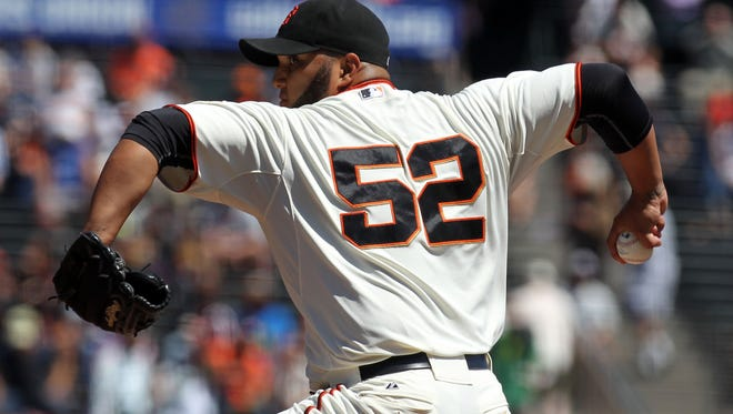San Francisco Giants starting pitcher Yusmeiro Petit throws to the Colorado Rockies in the first inning of their MLB baseball game at AT&T Park. Petit set a new MLB record retiring  46 batters in a row.