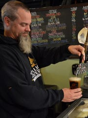 Mispillion River Brewing co-owner Eric Williams pours
