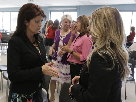Wisconsin Lieutenant Governor Rebecca Kleefisch talks with Tricia Braun of Wisconsin Economic Development Corporation Tuesday, Aug. 23, 2016, about the federal grant the WEDC received to support a collaborative effort to strengthen and diversify the economy in the region.