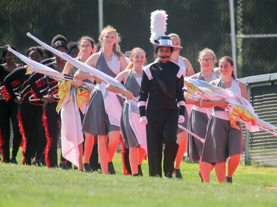 The William Penn High School marching band takes the field for its first halftime show of the season on Sept. 16 at Bill Cole Field.