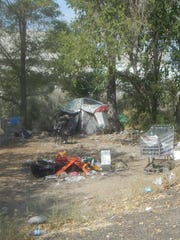 A homeless camp sits along the Truckee River in Sparks in 2015.