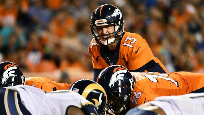 Aug 27, 2016; Denver, CO, USA; Denver Broncos quarterback Trevor Siemian (13) calls out from the line of scrimmage during the second quarter of a preseason game against the Los Angeles Rams at Sports Authority Field at Mile High.
