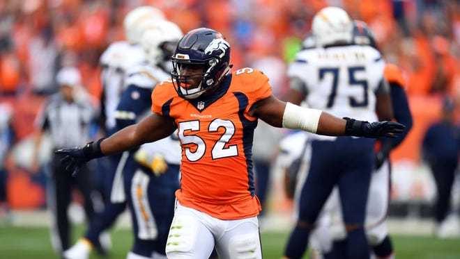Broncos linebacker Corey Nelson (52) reacts to a special teams play in the second quarter against the Chargers.