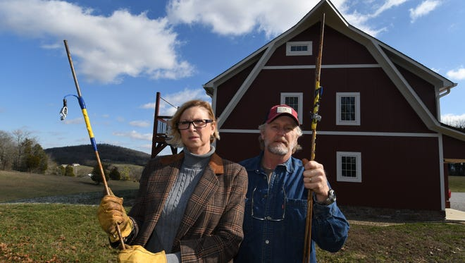Cynthia and Gary Lynn, of Pinto Ridge, show some of the 6-foot metal rods left on their property Monday, Jan. 30, 2017. The rods were left by a contractor, hired by Nyrstar Tennessee Mines, who the Lynns say left them behind lying flat in the yard where they were hidden in the grass and easily hit while mowing.