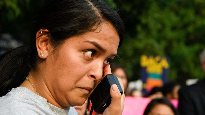 Evelin Salgado wipes away tears as she shares her fears she has after the Trump administration has said it would rescind the Deferred Action for Childhood Arrivals act during a protest at Senators Lamar Alexander's and Bob Corker's offices Tuesday, Sept. 5, 2017 in Nashville, Tenn.