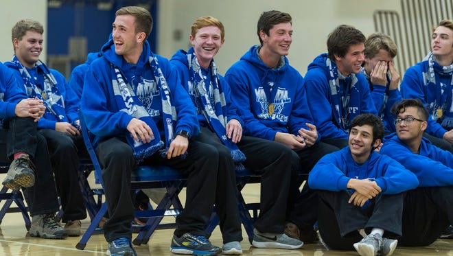 Andrew Cross (left) laughs with his teammates after making a speech during a state championship celebration held at Memorial High School in Evansville, Ind., Sunday, Oct. 29, 2017. The boys team defeated Fort Wayne Concordia Lutheran, 2-0, to win a back-to-back state championship title and the girls team defeated South Bend St. Joseph, 3-1.