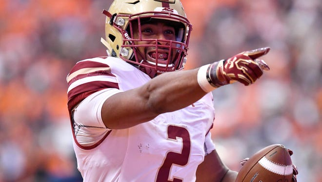 Boston College Eagles running back AJ Dillon celebrates scoring a touchdown during the first quarter of game against the Syracuse Orange at the Carrier Dome.