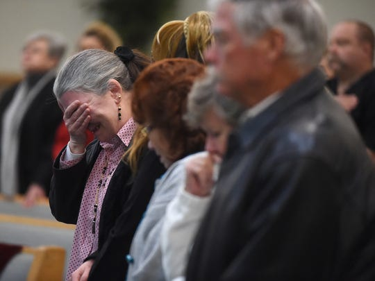 Members of Perry Boore's family react during a celebration service for Boore at Twin Lakes Baptist Church on Saturday.