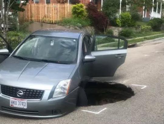 The sinkhole opened on a residential street in Cincinnati's