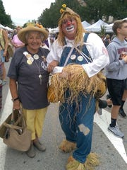 Rose Dillner, one of the founders of the Shippensburg Corn Fesitval, with Corny at the 2014 festival.