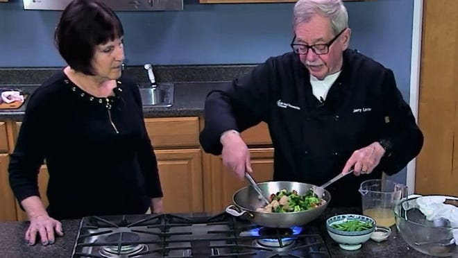 Marcia Richards and Jerry Levine stir up some stir fry on the set.