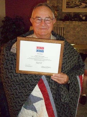 Ronald Berger, US Navy, 1962-1966, Vietnam, was recently awarded a Quilt of Valor by Mountain Home Quilts of Valor. Berger served on an LST in Vietnam. The award ceremony took place at his home with friends and family.