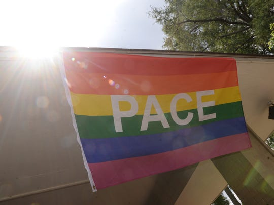 The PACE flag waves in the breeze as the sun beats down on Betty Virginia Park Saturday for the Pride in the Park event.