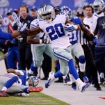 Dallas Cowboys running back Darren McFadden (20) is pushed out of bounds by New York Giants strong safety Brandon Meriweather (22) in the first half during the NFL game at MetLife Stadium.