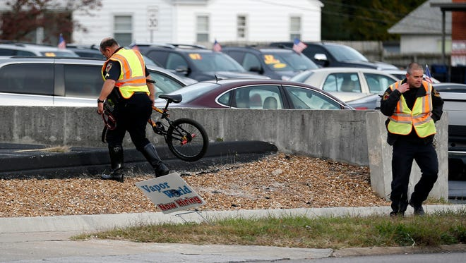 A woman pushing a bike across Glenstone Ave is dead after she was hit by a truck on the morning of Friday, Oct. 27, 2017