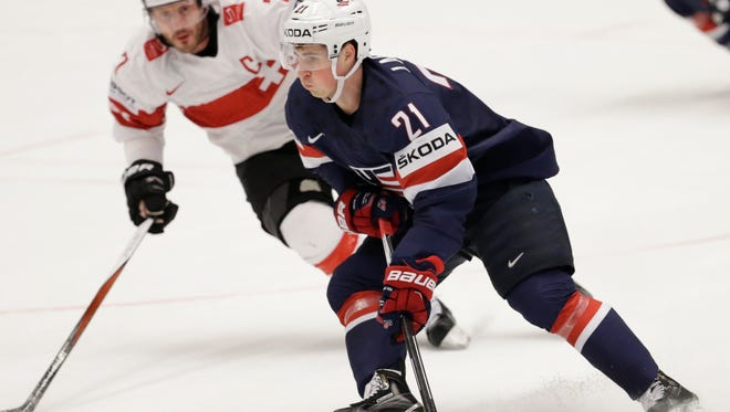 Dylan Larkin, of the United States, controls the puck during the hockey world championships quarterfinal match between United States and Switzerland, in Ostrava, Czech Republic, Thursday.