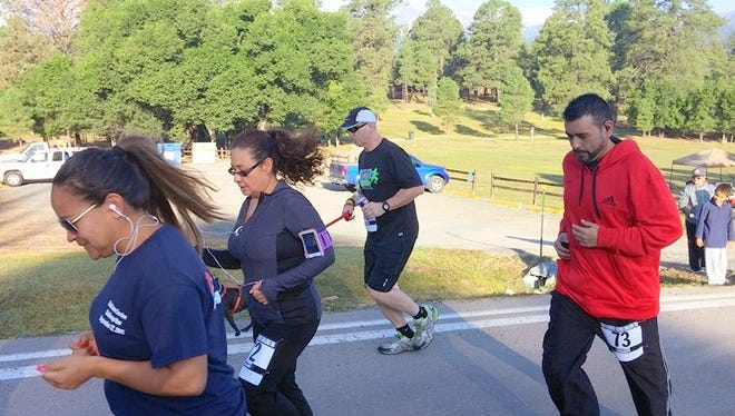Runners enjoy Ruidoso weather during a previous 5K event. The village offers a cool setting for summer runs and beautiful scenery year-round.