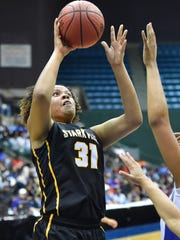 Starkville's Kristen Thompson (31) shoots against Murrah