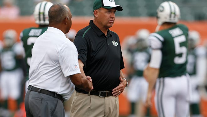 Bengals head coach Marvin Lewis and New York Jets head coach Rex Ryan talk prior to their game Saturday at Paul Brown Stadium.