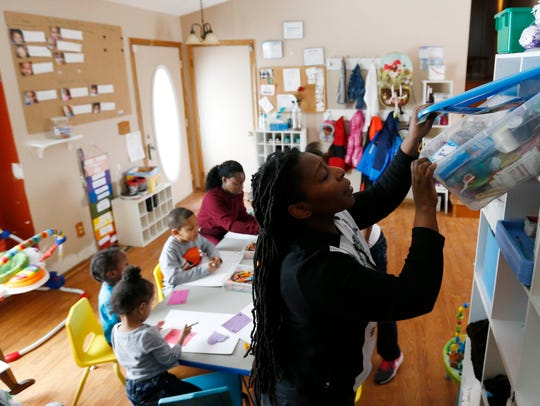 Tonja Boggs pulls out glue from a bin of supplies Feb.