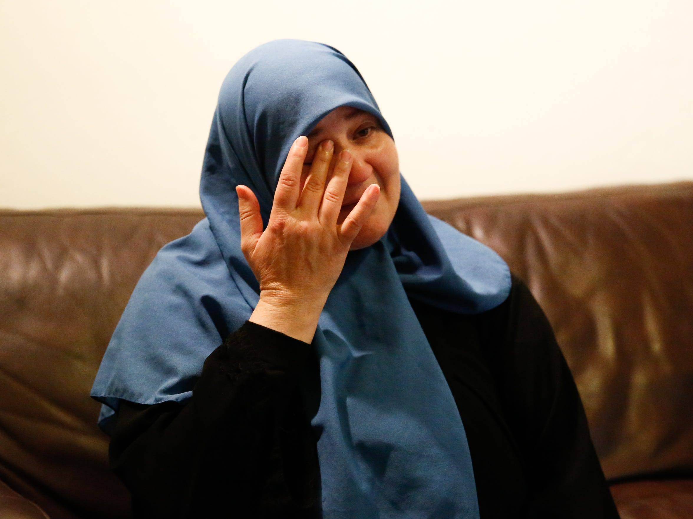 Osaima Alhalabi tears up while bringing up memories of her family who relocated to Jordan during the ongoing Syrian Civil War.