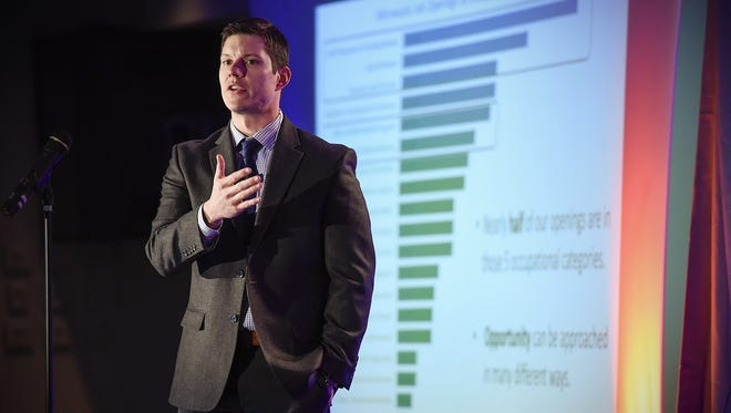 Luke Greiner, regional analyst for the Minnesota Department of Employment and Economic Development, presents his information during the Winter Institute economic summit Thursday, Feb. 23, at the Regency Plaza. DEED data shows increased hiring in health care and education sectors in the past year.