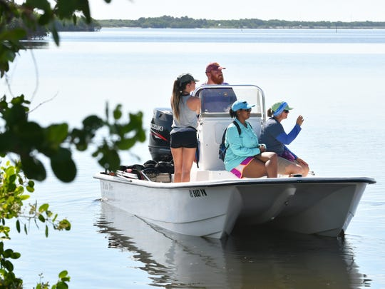 Three small boats of University of Central Florida students and biologists head out from Sebastian Inlet south side boat ramp to research turtle viruses and tumors.