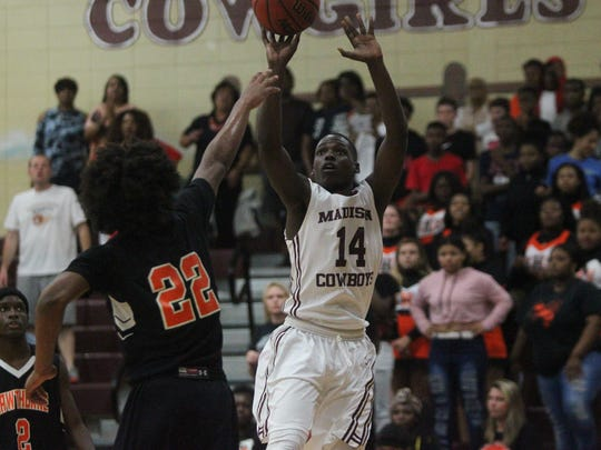 Madison County's Demarvion Brown drills a jumper as part of his 23 points during a Region 3-1A final win against Hawthorne.